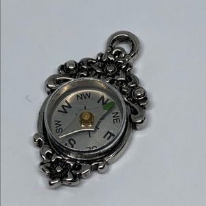 Compass pendant. Articulated silver tone NWOT